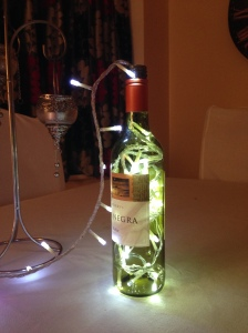 Fill an empty wine bottle with fairly lights for extra sparkle on the table.