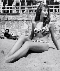 1953 Bridget Bardot on the beach during the Cannes Film Festival.